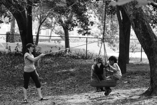 mon swinging kids on a tire swing